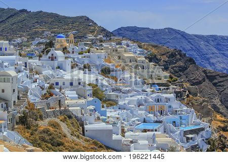 View of colorful Oia village on Santorini island by beautiful day, Greece