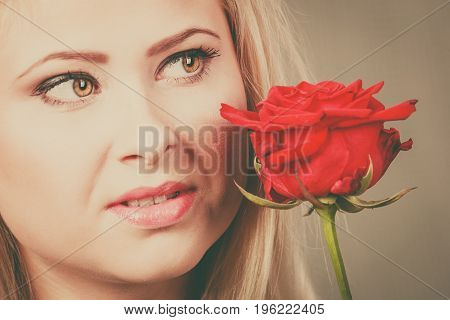 Woman Holding Red Rose Near Face Looking Melancholic