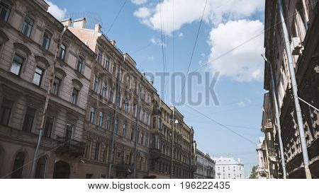 Petersburg houses on a background of a bright blue sky. City landscape