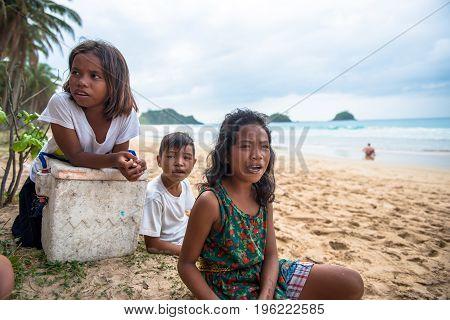 EL NIDO PALAWAN PHILIPPINES - JANUARY 20 2017: Filipino trio singing local songs at Nacpan Beach during a sunny day Philippines.