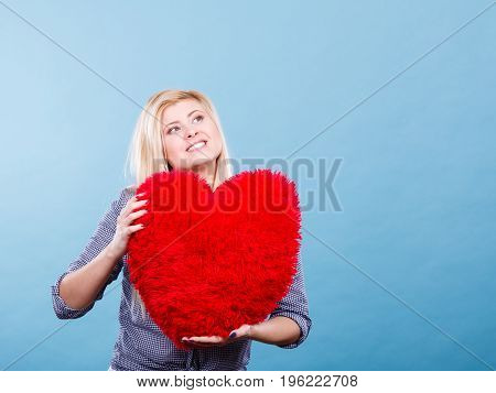 Happy Woman Holding Red Pillow In Heart Shape