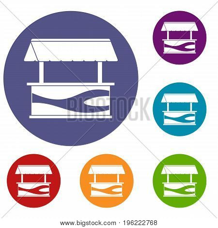 Market stall with awning icons set in flat circle red, blue and green color for web