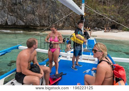 EL NIDO PALAWAN PHILIPPINES - JANUARY 19 2017: Foreigners from different countries doing island hopping in El Nido.