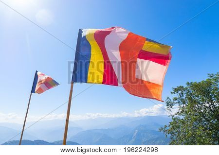 Colurful Buddhist Prayer flags are waving in strong wind under sunshine at Samdruptse huge buddhist memorial Monastery in Sikkim India.