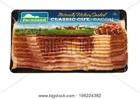 Winneconne WI - 20 July 2017: A package of Farmland bacon on an isolated background.