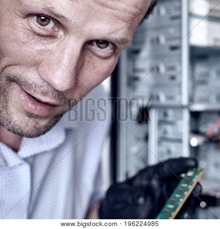 Close up of proffessional engineer repairing computer and fixing ram Memory card. Square aspect ratio with toning
