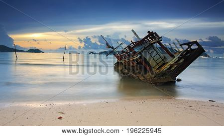 Seascape With Wreck Ship At Sunrise