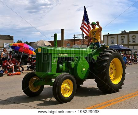 MANDAN, NORTH DAKOTA, July 3, 2017: The 4th of July Rodeo Days 3 day celebration includes the rodeo, Art in the Park, and downtown parade where this John Deer two cylinder 80 tractor is displayed
