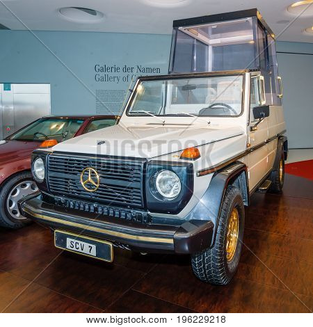 STUTTGART GERMANY- MARCH 19 2016: Mercedes-Benz 230G Papamobil 1980. A special armored vehicle for the transportation of Pope (Bishop of Rome). Mercedes-Benz Museum.