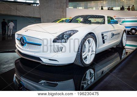 STUTTGART GERMANY- MARCH 19 2016: Luxury car Mercedes-Benz SLS AMG Coupe Electic Drive 2012. Mercedes-Benz Museum.