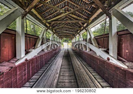 Built in 1881 the Glessner Covered Bridge crosses the Stonycreek River near Shanksville in rural Somerset County Pennsylvania.