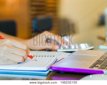 woman working with calculator business document and laptop computer notebook