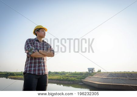 Male Employee Standing To A Public Floodgate.