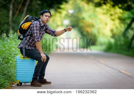 Backpacker is hitchhiking man on the load.
