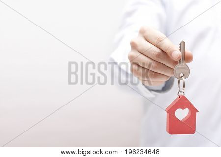 House key with heart in hand