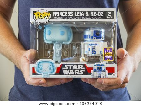 NEW YORK: JULY 20 2017 - Man holds a San Diego Comic Con Exclusive Funko POP release of the Star Wars Princess Leia & R2D2 pack. SDCC Exclusive available only at GameStop & ThinkGeek stores