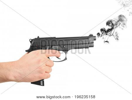 Man holding smoking gun on white background