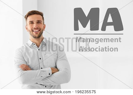 Concept of management association. Young businessman on light background