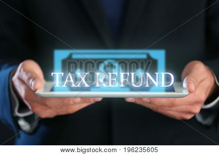 Man holding tablet, closeup. Tax refund concept