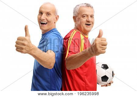 Cheerful elderly soccer players holding their thumbs up isolated on white background