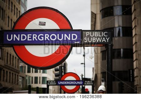 London, UK - 5 June 2017: London Underground street sign, with defocused second sign behind, showing the entrance to the tube station.