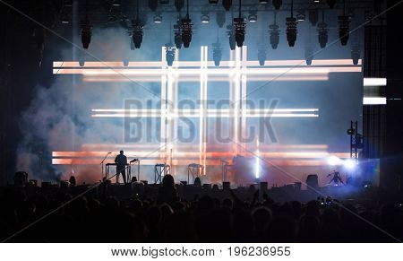 Music band silhouette on stage, night entertainment, music festival