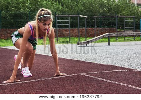 A young beauty athletic woman in sportswear ready for running at outdoor.