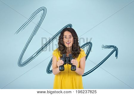 Digital composite of Happy woman with binoculars against blue background with arrow