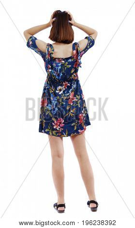 Back view of shocked woman in dress. upset young girl. Rear view people collection.  backside view of person.  Isolated over white background. The short-haired girl clutched her head.