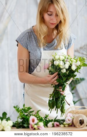 Portrait of blonde with bouquet
