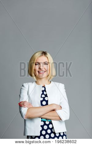 Smiling blonde with arms crossed