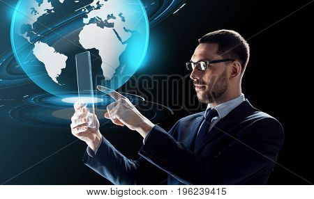business, augmented reality and future technology concept - businessman in glasses working with transparent tablet pc computer and virtual earth globe hologram over black background