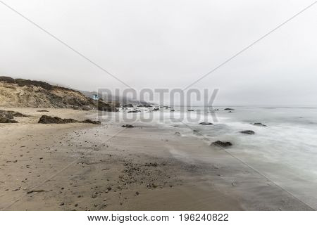Leo Carrillo State Beach with motion blur water and clouds in Malibu, California.
