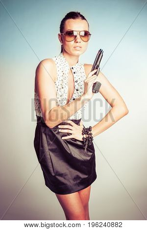 Beautiful sexy woman holding gun