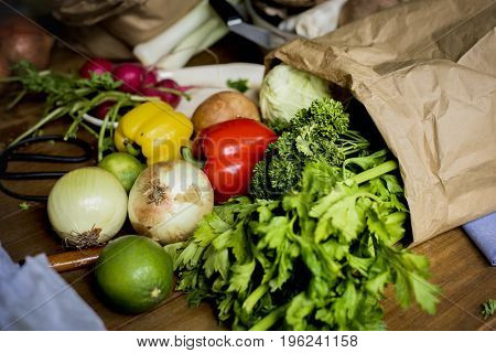 Fresh vegetable in a paper bag on the table