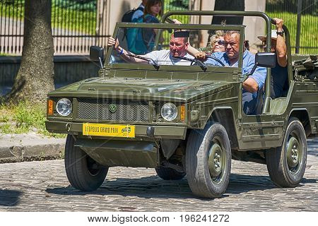 Lviv Ukraine - June 4 2017: Old retro car Volkswagen Type 181 with its owner and au unknown passengers taking participation in race Leopolis grand prix 2017 Ukraine.