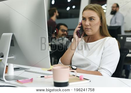 Woman working with computer at the office