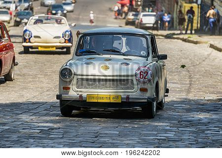 Lviv Ukraine - June 4 2017: Old retro car Trabant 601 with its owner and au unknown passenger taking participation in race Leopolis grand prix 2017 Ukraine.