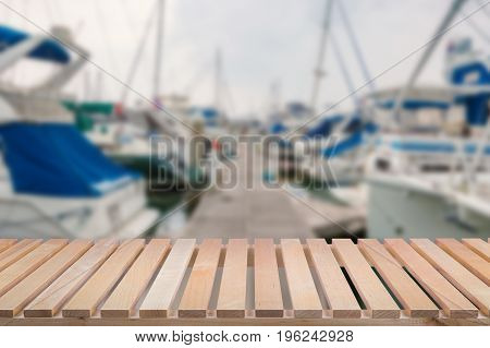 wooden pier with yacht club blurred background