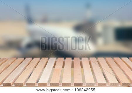 Wooden Table With Airplane Blurred Background