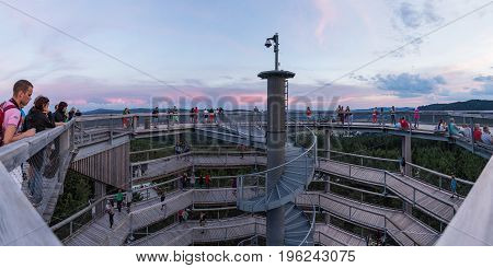 LIPNO CZECH REPUBLIC - 18 July 2017. A group of people are at the top of the observation tower and watch the surroundings. Treetop Walkway in Lipno.