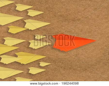 leadership concept with paper plane as a leader on brown background