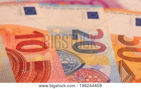 Close up of Euro notes on a table financial concept background selective focus on foreground