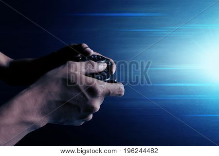 Man playing video games with wireless joystick