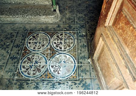 Vintage decorative floor tiles in an old house. Look down.