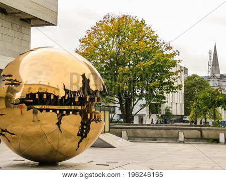 The Sphere Within Sphere, Sculpture Of The Italian Sculptor Arnaldo Pomodoro.trinity College, Dublin