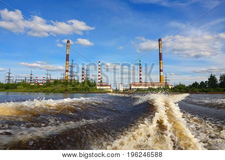 Electric station.Industrial facility.Industrial facility electricity production on the background of blue sky.
