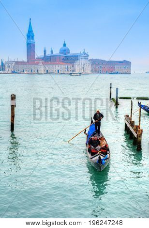 Gondolier on the famous Grand Canal, in Venice Italy
