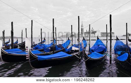 Traditional gondolas on the canal, in Venice - Italy