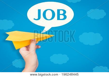 hand holding paper plane with job in speech bubble on blue background illustration